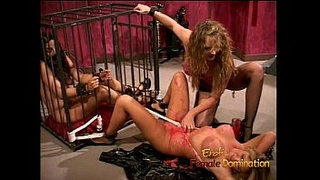 Stacked-blonde-bimbo-gets-spanked-while-a-caged-slut-watches
