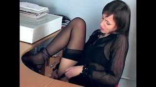 Office-babe-fingering-in-sheer-stockings-and-heels