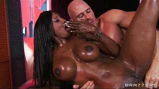 Curvy-ebony-masseuse-oils-herself-up-for-some-deep-anal