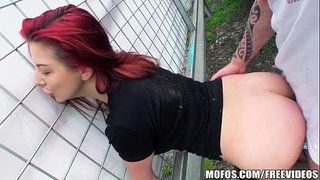Sexy-redhead-amateur-is-fucked-in-a-park-for-some-cash