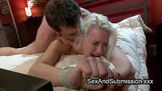 Tied-blonde-fucks-in-bed-from-behind-by-stiff-dick