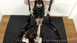 Rubber-nurse-anally-fists-her-male-slave