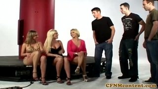 CFNM-babes-sucking-gloryhole-cock