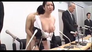 Japanese-wife-undressed,apologized-on-stage,humiliated-beside-her-husband-01-of-02