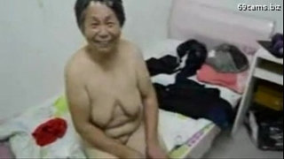 Asian-Grandma-get-dressed-after-sex