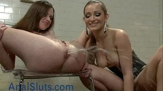 Babe-gets-enema-and-squirts-in-femdom