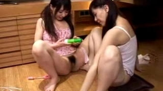 2-Young-Schoolgirls-In-Lingerie-Sticking-Toys-To-Each-Other-Pussies-On-The-Floor
