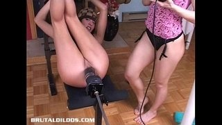 Sandy-pounded-hard-by-a-brutal-dildo-machine